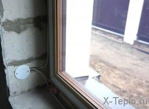 Установленная на окно система электрообгорева